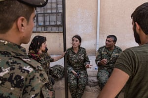 Military operations officers of the SDF have a meeting