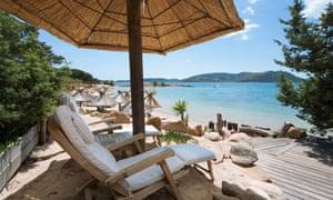 Sun Loungers on the beach at the Grand Hotel Cala Rossa near Porto Vecchio, Corsica