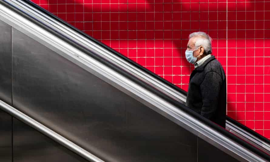 A man wearing a face mask exits the subway in Los Angeles. The state's testing efforts have been hampered by a backlog and by a shortage of test kits.