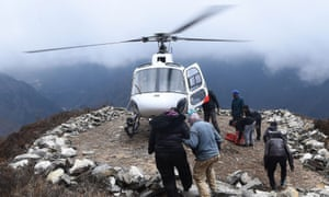 A rescue helicopter picks up a patient on the route to  Everest base camp