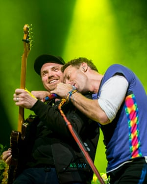 Jonny Buckland and Chris Martin performing