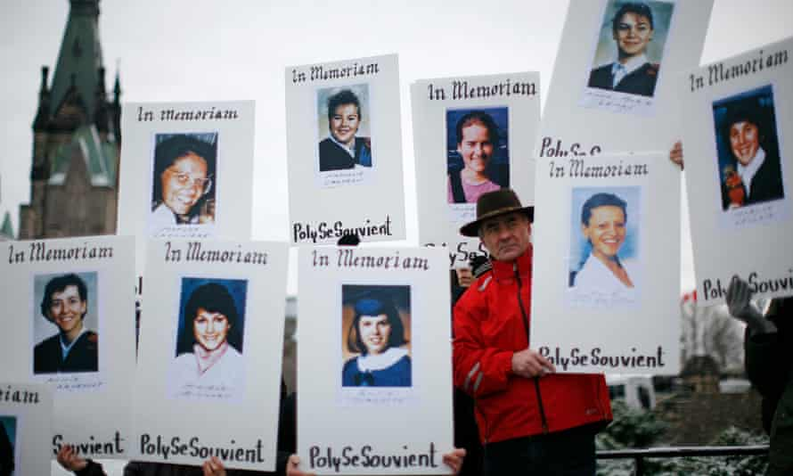 Demonstrators hold portraits during a rally to commemorate the Montreal mass shooting of 14 female engineering students in 1989.