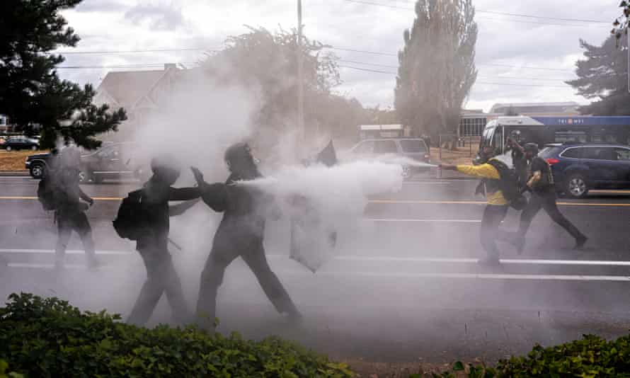 Mace and smoke filled the air in suburban Portland on Sunday.