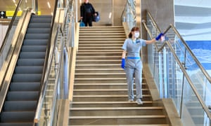 An employee disinfecting a staircase at Krasnoyarsk international airport, Russia