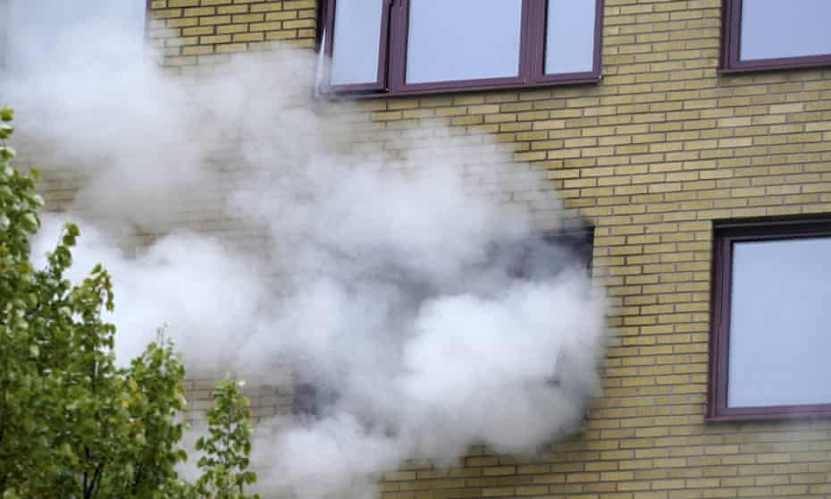 Smoke billows from an apartment building after an explosion in Annedal, central Gothenburg