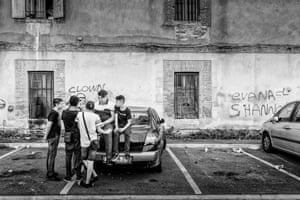 Youths gather in a car park behind the Caserne St Jacques on the Place du Puig. The former military building, which dates from the 17th century, now houses low-income families in council-owned apartments.