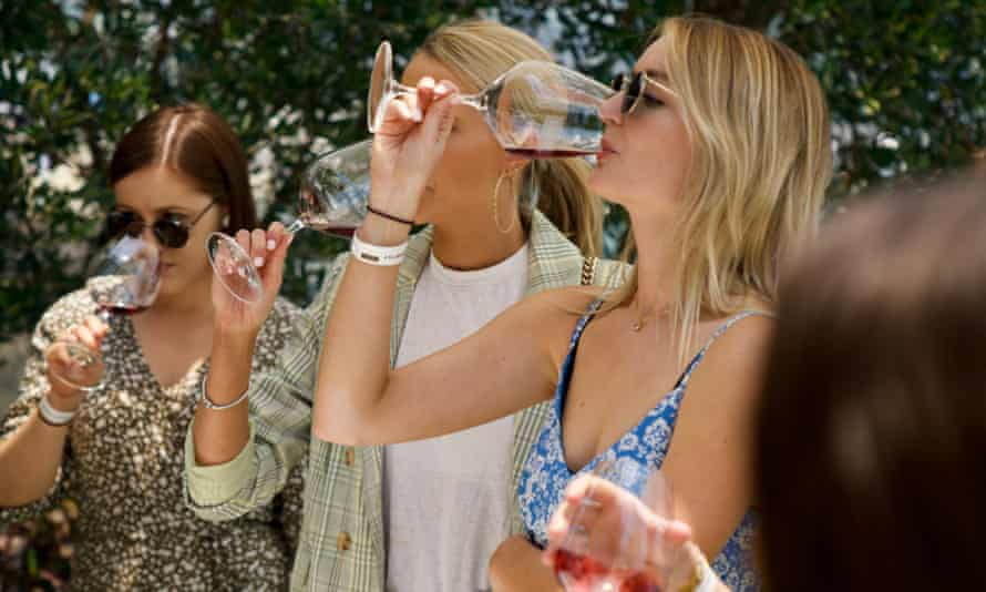 Guests drinking cold red wine at Taylors Summer House Of Shiraz in December 2019
