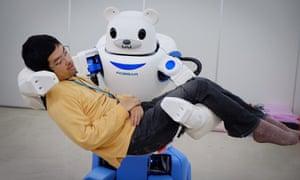 Cold comfort … RoBear, a robot bear, cradling a human