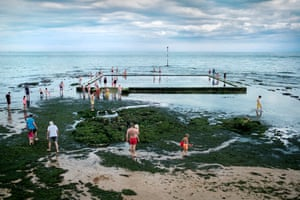 People enjoy the warm temperatures at the Viking Bay tidal pool in Broadstairs, Kent.