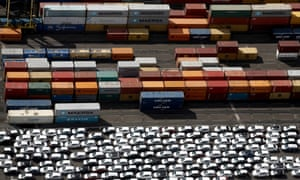 Shipping containers and new cars sit dockside at the Port of Tilbury in Essex