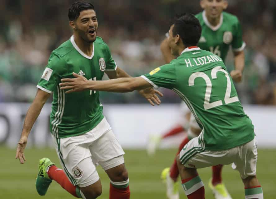 Carlos Vela celebrates with Hirving Lozano after scoring for Mexico against USA in a World Cup qualifier at the Estadio Azteca.