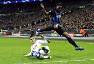 Inter's Kwadwo Asamoah, right, is challenged by Tottenham's Erik Lamela.