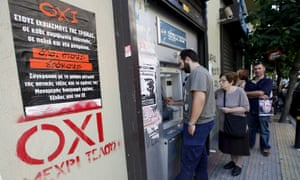 Referendum campaign posters reading 'no' at a cash machine in Athens.