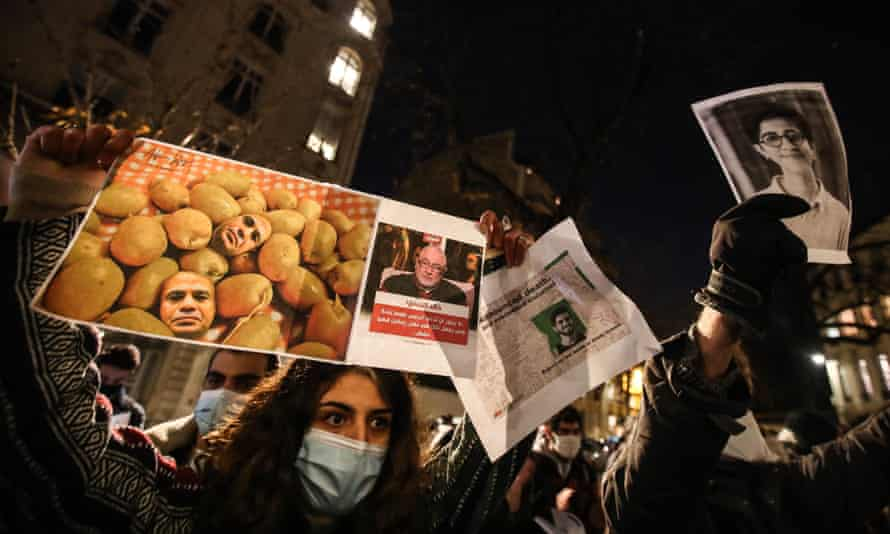 Protestors hold placards during a protest against Egyptian president Abdel Fattah Al-Sisi's state visit to France, in Paris, France, 8 December 2020.