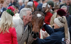 Owner Michael O'Leary plants a kiss on his horse Tiger Roll after they won the Cross Country Chase.