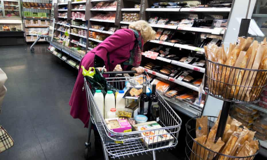 Senior woman with trolley shopping in Marks & Spencer
