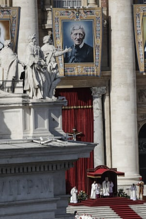 A tapestry portraying Cardinal John Henry Newman hangs from St Peter's Basilica, at the Vatican last Sunday to honour his canonisation.