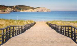 Gorliz boardwalk to the beach on sunny day