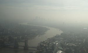 A view of London over Tower Bridge, lower left, the river Thames and east towards Canary Wharf, top, which is just visible through haze and smog last April.