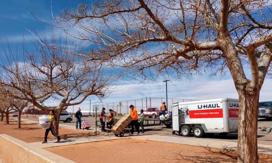 Volunteers unload goods at the relief fund's makeshift distribution center at Mount Valley high school, Oljato, Utah.