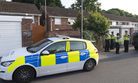Police community support officers outside a house believed to be Darren Osborne's home.