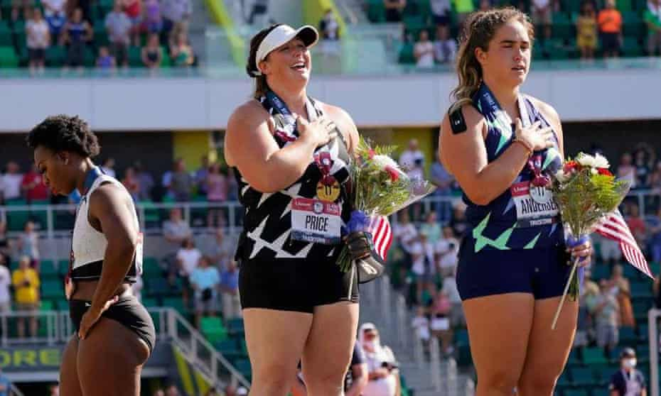 Gwen Berry (left) turns away during the national anthem at the US Olympic trials