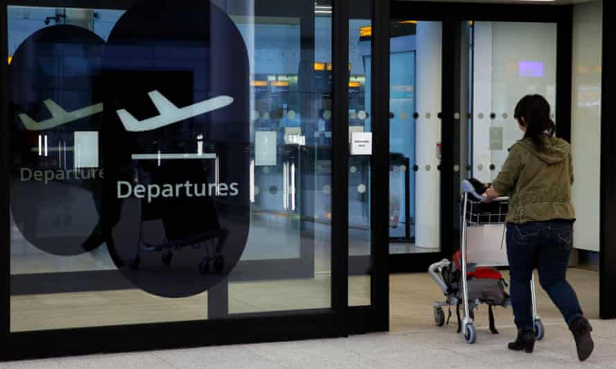 A passenger enters departures in Terminal 2 at Heathrow Airport
