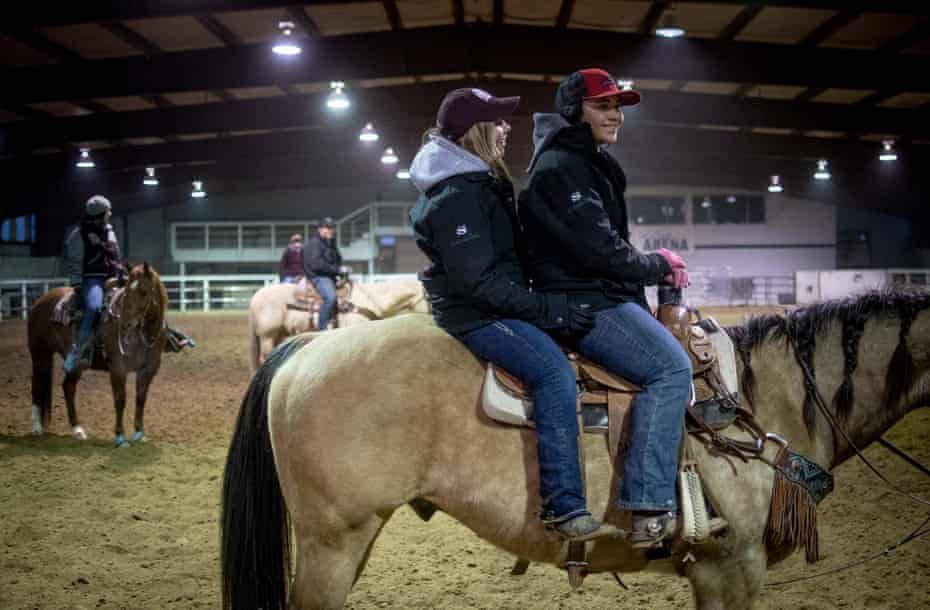 Simonson and Alexis Rose, a close friend, mess around on horseback together at the first University of Montana rodeo team practice of 2019 in February, outside of Lolo, Montana.
