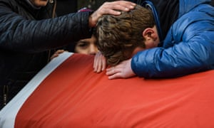 Relatives of one of the victims mourn