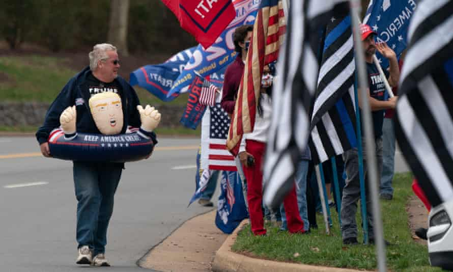 Raymond Deskins wears an inflatable toy supporting Donald Trump at a protest outside Trump National Golf Club, in Sterling, Virginia, on Saturday.