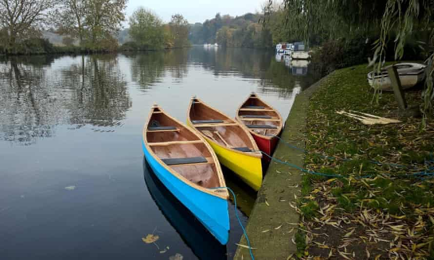 The canoes are handcrafted by Nick and have bright, primary colour paint jobs