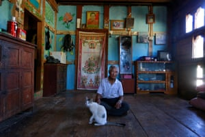 Zeko, 73, at his home in Punakha. He says: 'I'm happy to have a mobile phone so I can talk to my relatives and children any time I want.'