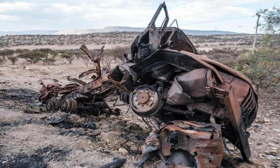 A destroyed military vehicle lies at the roadside north of Mekele, the capital of Tigray