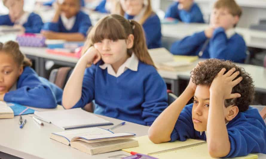 School children listen in to a lesson in class.