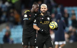 Mendy congratulates Aguero on his hat-trick and their 6-1 victory.