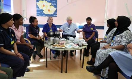 Boris Johnson sits with staff at Whipps Cross hospital