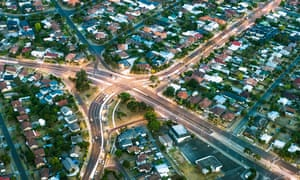 Aerial view of major roads cutting through housing developments in suburban Melbourne, Australia.