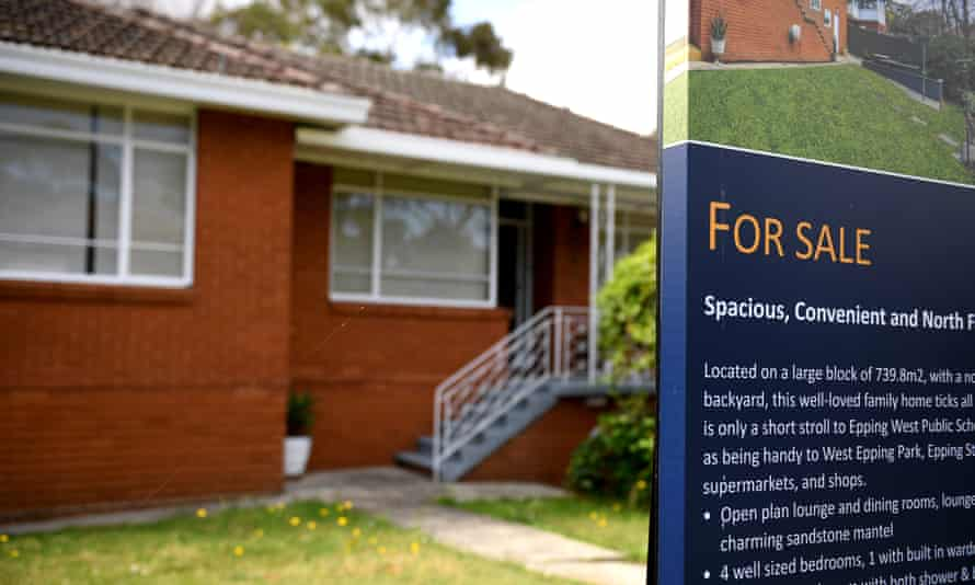 A For Sale sign is seen outside a house in Sydney