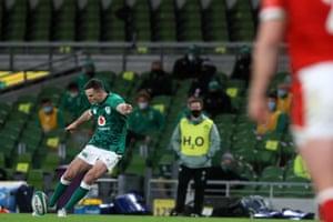 Ireland's fly-half Jonathan Sexton kicks the first penalty.