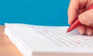 Hand with Red Pen Proofreading a Manuscript