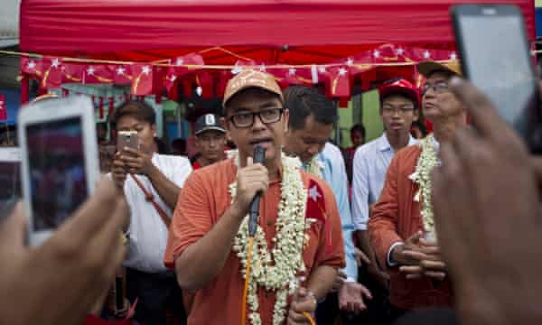 Blogger and internet freedom activist Nay Phone Latt, centre, for the NLD, delivers a speech during the election campaign.