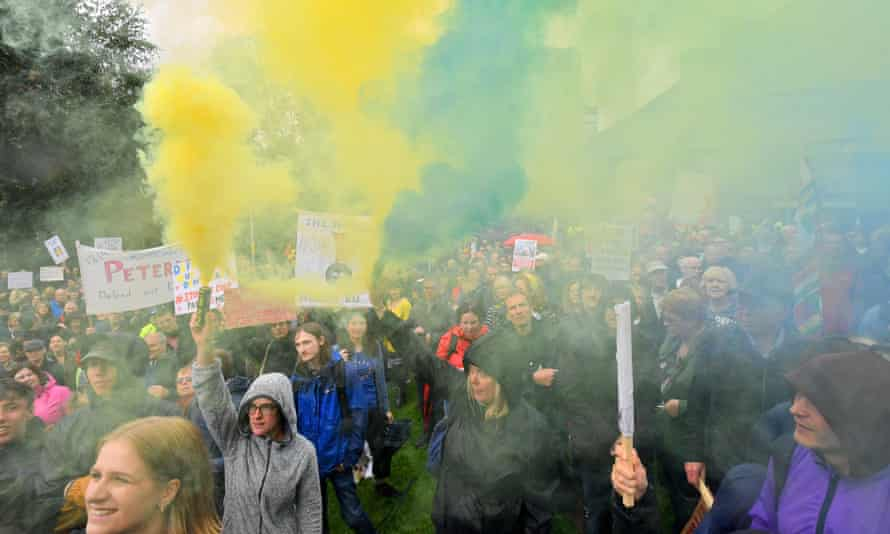 Demonstrators let off flares in Cathedral Gardens in Manchester.
