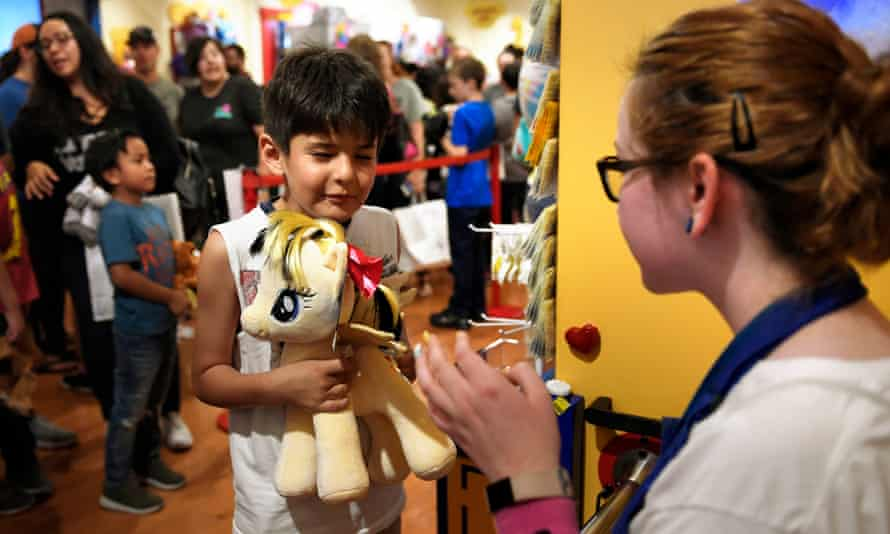 Romeo Erickson, seven, of Aurora, Colorado, hugs his My Little Pony tight after it was built.