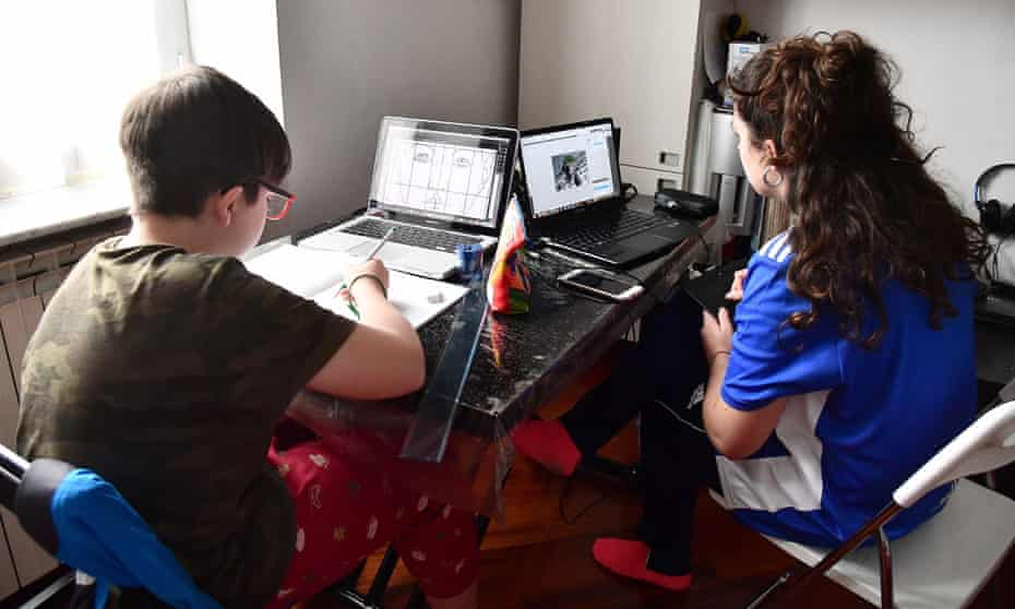 Two students doing schoolwork at home in Genova, Italy in March.