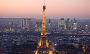 FILE PHOTO: A general view shows the illuminated Eiffel Tower and the skyline of La Defense business district at night in ParisFILE PHOTO: A general view shows the illuminated Eiffel Tower and the skyline of La Defense business district (rear) at night in Paris, France, November 28, 2016. REUTERS/Charles Platiau/File Photo