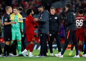 Liverpool manager Jürgen Klopp congratulates Mohamed Salah on his goals.