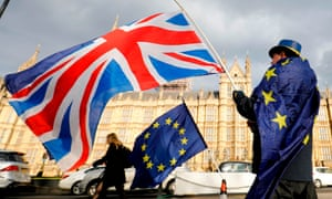 demonstrator waves uk and eu flags outside house of commons