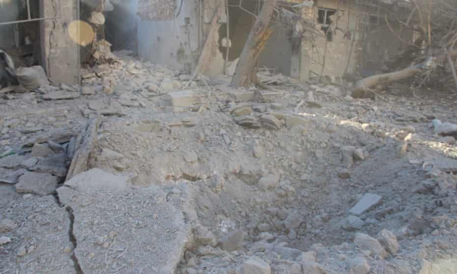 A crater allegedly formed by a bunker-buster bomb is seen in the Mashdad area of Aleppo on Monday.