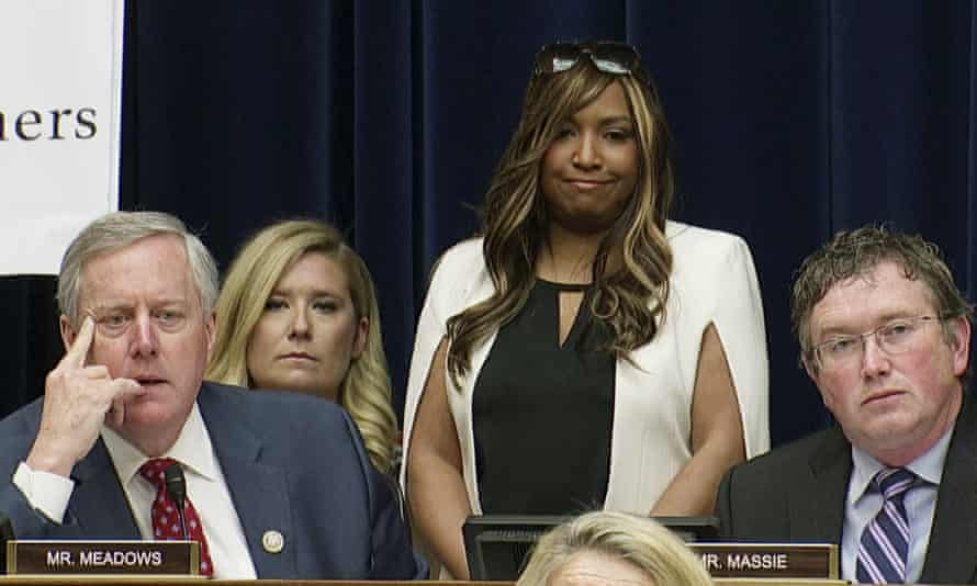 Lynne Patton, center, stands behind Mark Meadows as he questions Michael Cohen in Washington DC on 27 February.