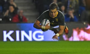 Handré Pollard, the South Africa fly-half, flies over to score the Springboks' second try in a thrilling victory over Scotland.